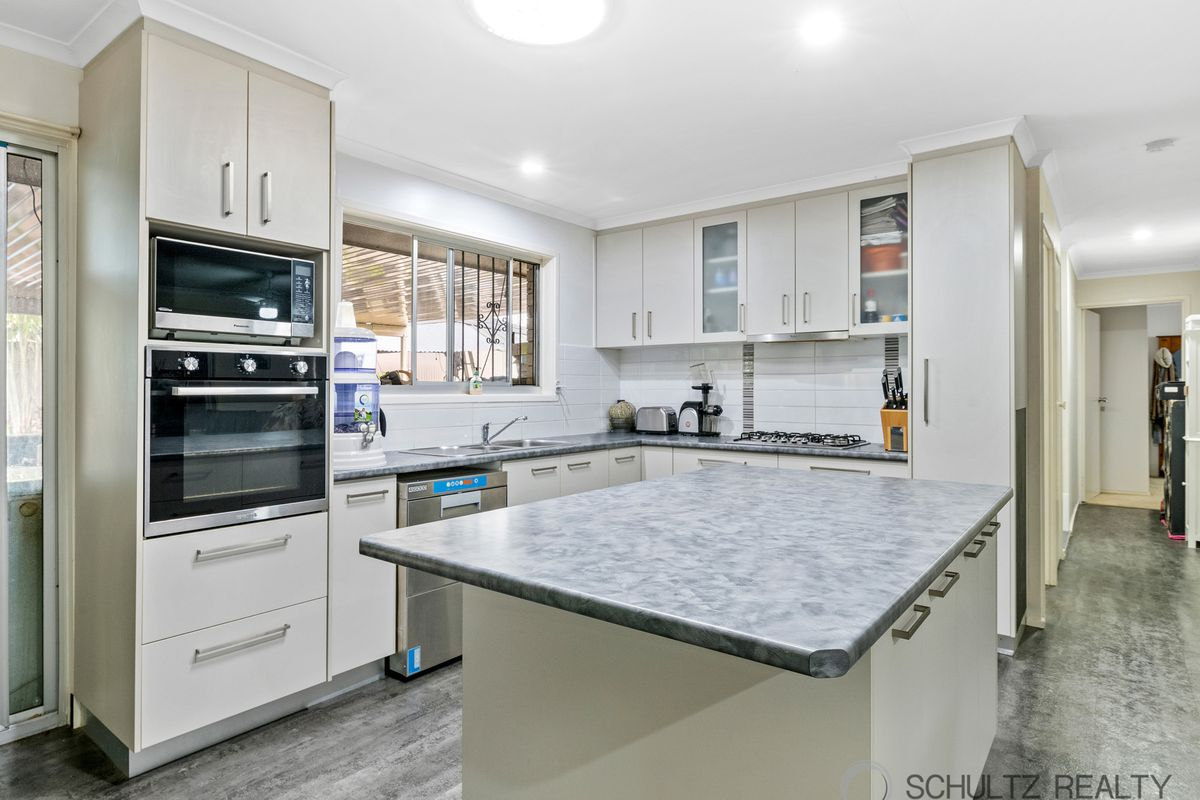 Brick and tile 3 bedroom 1 bathroom home with renovated kitchen and high double carport
